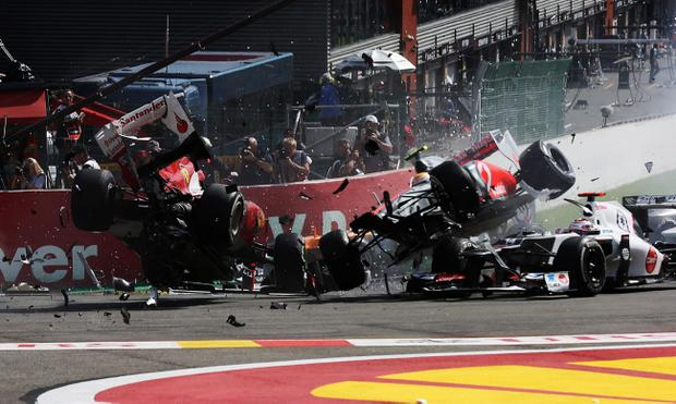 SPA, BELGIUM - SEPTEMBER 02: Fernando Alonso (L) of Spain and Ferrari and Lewis Hamilton (R) of Great Britain and McLaren collide and crash out at the first corner at the start of the Belgian Grand Prix at the Circuit of Spa Francorchamps on September 2, 2012 in Spa Francorchamps, Belgium. (Photo by Mark Thompson/Getty Images)