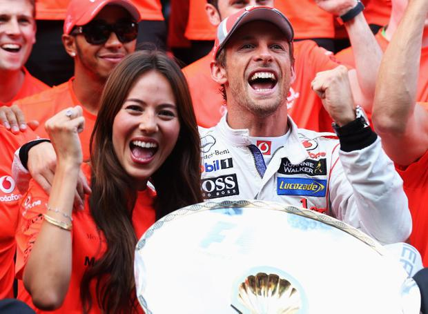 SPA, BELGIUM - SEPTEMBER 02: Jenson Button of Great Britain and McLaren celebrates in the paddock with his girlfriend Jessica Michibata and team mates after winning the Belgian Grand Prix at the Circuit of Spa Francorchamps on September 2, 2012 in Spa Francorchamps, Belgium. (Photo by Mark Thompson/Getty Images)