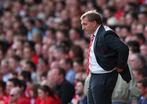 Brendan Rodgers claims every time Liverpool striker Luis Suarez takes a step forward he is 'struck down'