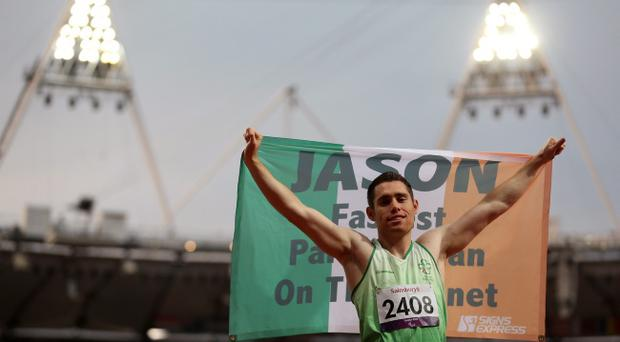 LONDON, ENGLAND - SEPTEMBER 01: Jason Smyth of Ireland celebrates winning gold and breaking the world record in the Men's 100m - T13 Final on day 3 of the London 2012 Paralympic Games at Olympic Stadium on September 1, 2012 in London, England. (Photo by Julian Finney/Getty Images)
