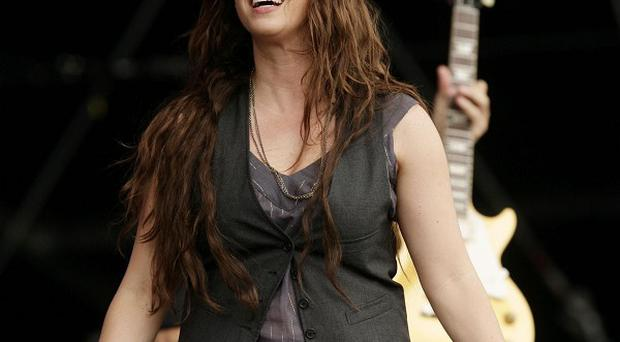 Alanis Morissette said it wasn't easy penning music while she was expecting