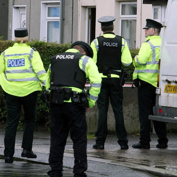 A man has been assaulted with baseball bats at a house in Carrickfergus, police say