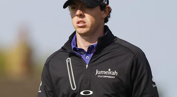 Rory McIlroy leads by one shot from Louis Oosthuizen and two from Tiger Woods