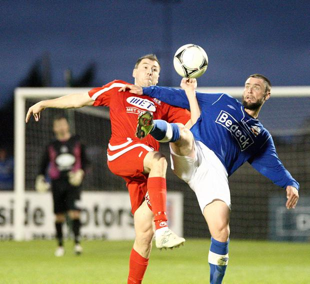Portadown's Brian Gartland and Glenavon's Gary Hamilton during Monday night's game at Mourneview Park, Lurgan