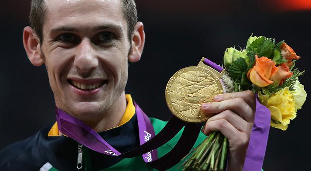Michael McKillop celebrates winning Gold in the Men's 800m T37 Final in a new world record time