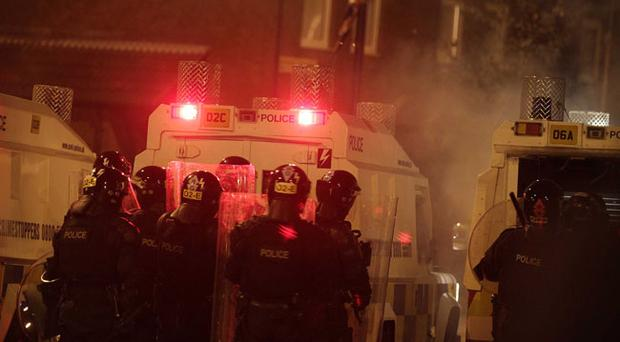 Police pictured on Denmark Street off Carlisle Circus in Belfast during a third night of rioting with loyalists