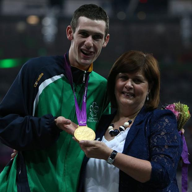 Michael McKillop receives his gold medal in the Mens 1500m T37 from his mother Catherine at the Olympic Stadium, London