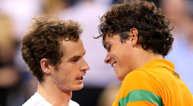 NEW YORK, NY - SEPTEMBER 03: Andy Murray of Great Britain talks to Milos Raonic of Canada after winning their men's singles fourth round match during Day Eight of the 2012 US Open at USTA Billie Jean King National Tennis Center on September 3, 2012 in the Flushing neighborhood of the Queens borough of New York City. (Photo by Cameron Spencer/Getty Images)