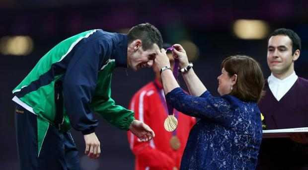 Proving his mettle: Michael McKillop and his mum at the Paralympics awards ceremony