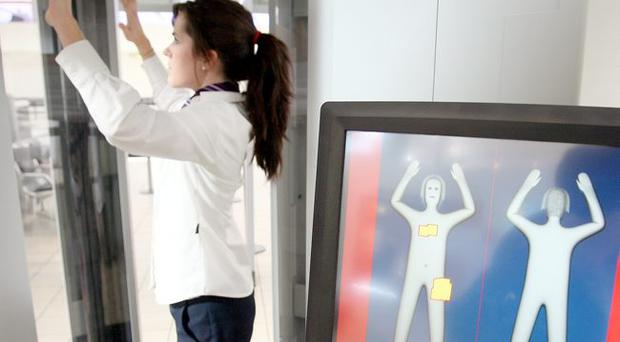 A volunteer tries the newly unveiled full-body scanner at Belfast International Airport
