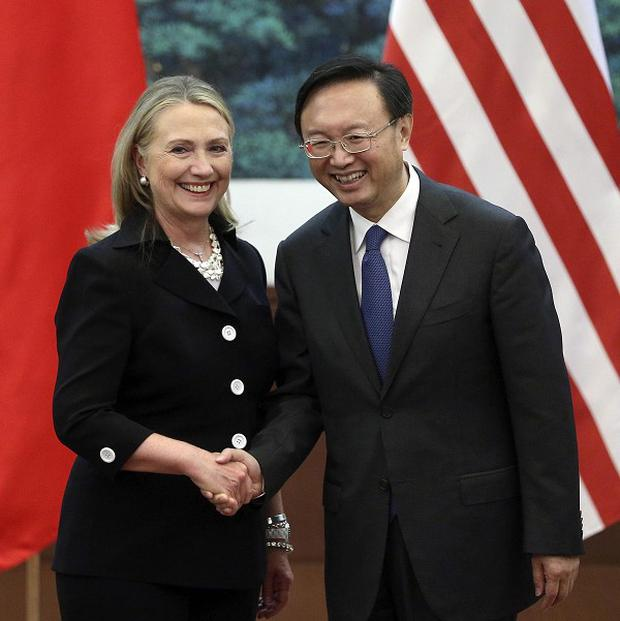 Chinese foreign minister Yang Jiechi and US secretary of state Hillary Clinton shake hands at the Great Hall of the People in Beijing (AP)