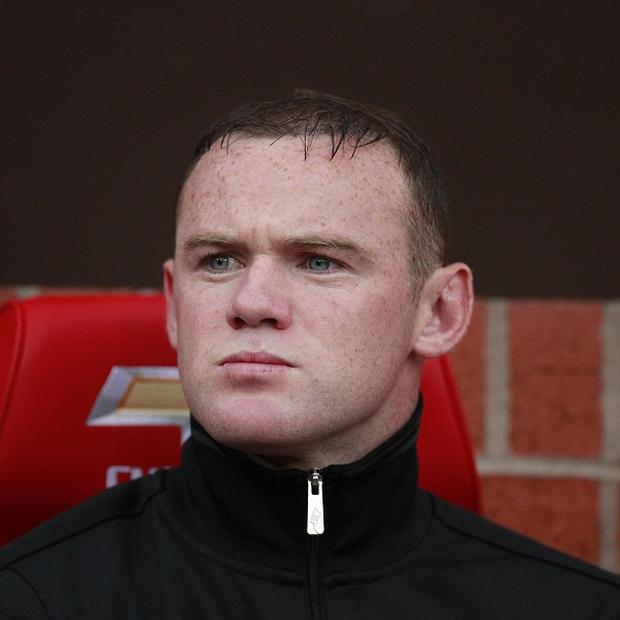 Manchester United striker Wayne Rooney revealed he put on seven pounds during the off-season