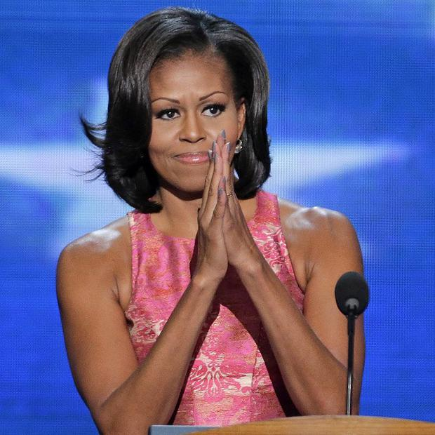 First lady Michelle Obama addresses the Democratic National Convention in Charlotte, North Carolina (AP)
