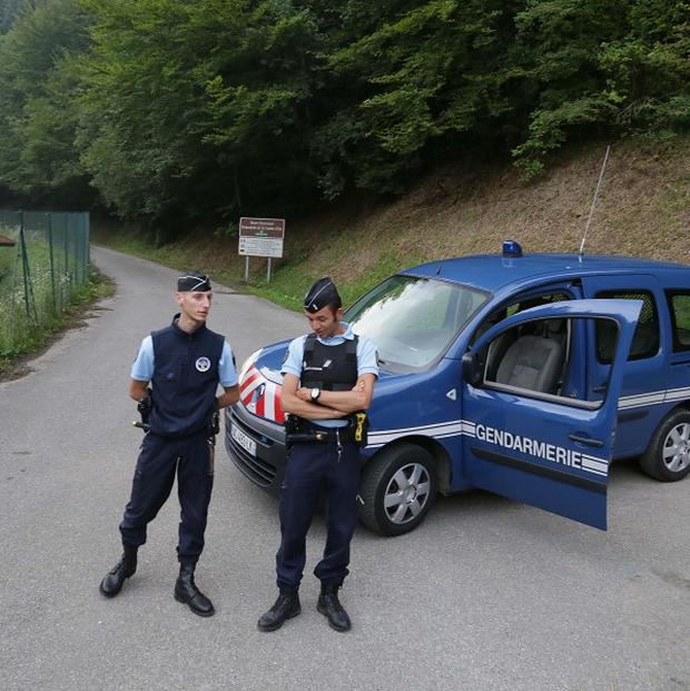 Gendarmes block access to the site of the shooting near Chevaline in the French Alps (AP)