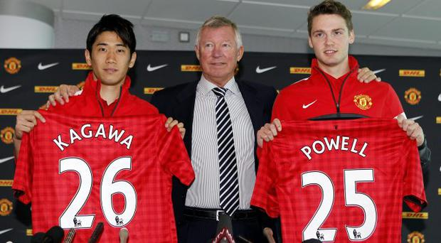 Fresh faces: Manchester United boss Sir Alex Ferguson welcomes Shinji Kagawa and Nick Powell to Old Trafford