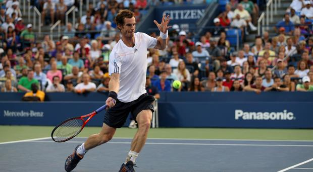 NEW YORK, NY - SEPTEMBER 05: Andy Murray of Great Britain returns a shot against Marin Cilic of Croatia during their men's singles quarterfinal match on Day Ten of the 2012 US Open at USTA Billie Jean King National Tennis Center on September 5, 2012 in the Flushing neighborhood of the Queens borough of New York City. (Photo by Clive Brunskill/Getty Images)