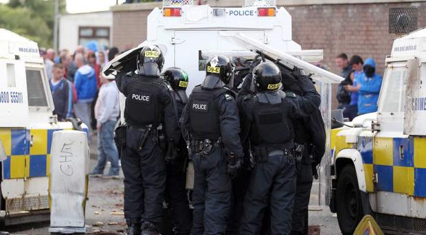 Battleground: the riots in north Belfast have been fanned, in some part, by Peter Robinson's outrage at the parades ruling