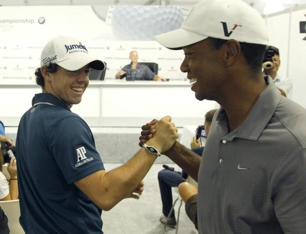 Rory McIlroy and Tiger Woods shake hands during the Pro-Am of the BMW Championship in Carmel, California