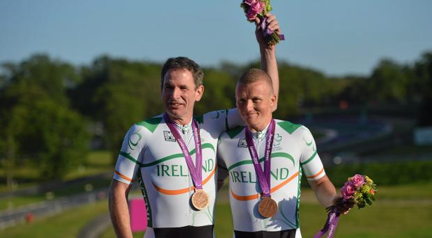 James Brown, left, and pilot Damien Shaw celebrate with their bronze medal after finishing third in the men's individual B time trial