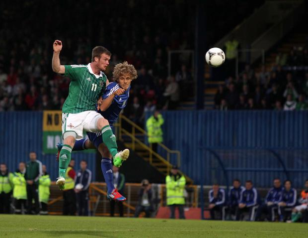 Chris Brunt, pictured in action against Finland last month, wants Michael O'Neill to move him from the flanks into the middle