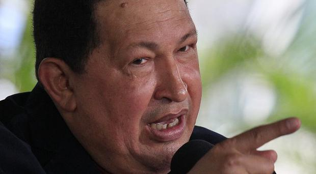 Venezuelan president Hugo Chavez came to the defence of embattled oil minister Rafael Ramirez