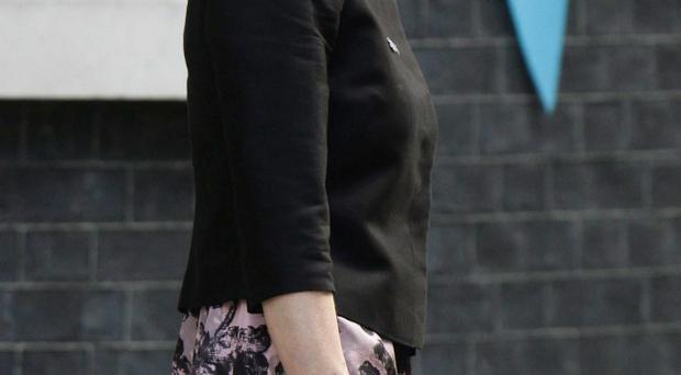 Newly named Northern Ireland Secretary Theresa Villiers leaves No 10 Downing Street in central London