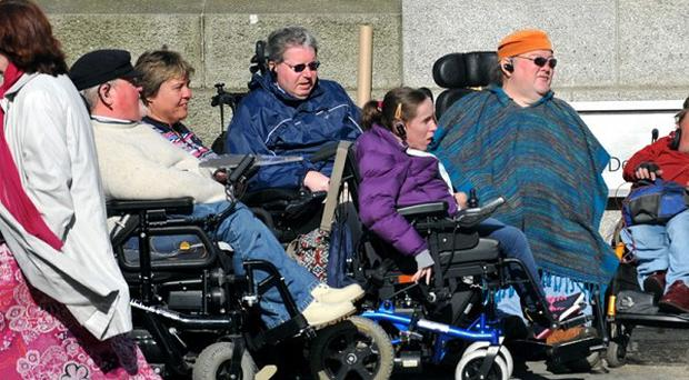 A group of people with disabilities who mounted a protest outside Government buildings