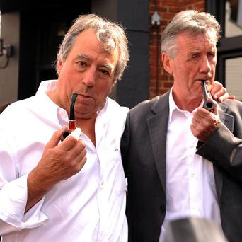 Terry Jones, left, and Michael Palin attend the unveiling of a plaque outside The Angel Inn in Highgate dedicated to Graham Chapman
