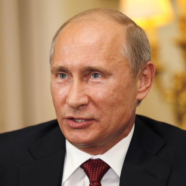Vladimir Putin said he will work with 'whichever president is elected by the American people'