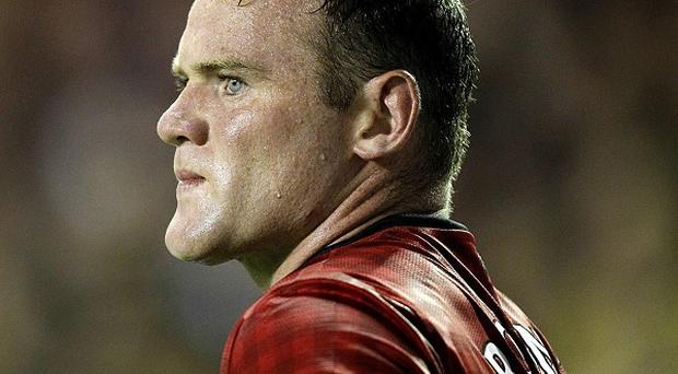 Wayne Rooney has spoken of his future playing plans in his autobiography