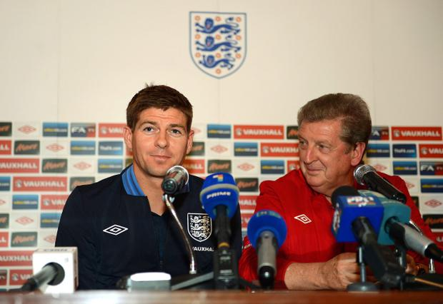 CHISINAU, MOLDOVA - SEPTEMBER 06: Steven Gerrard and England manager Roy Hodgson speak to the media before the England training session at Zimbru Stadium on September 6, 2012 in Chisinau, Moldova. (Photo by Michael Regan/Getty Images)