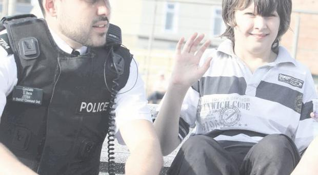 Constable Stevie Burns of the Causeway Coastal (Coleraine) neighbourhood team chats to a young holidaymaker in Portrush