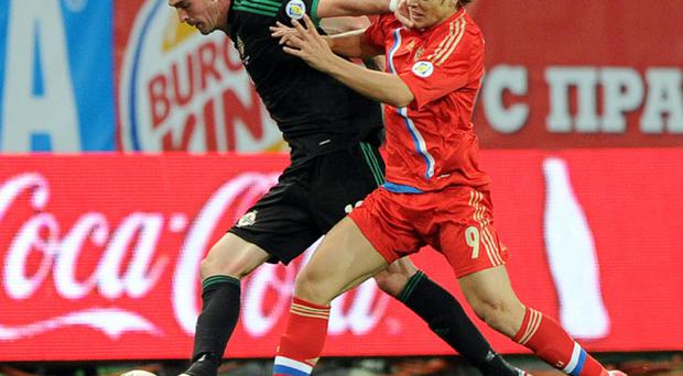 Russia's Alexander Kokorin (right) in action with Northern Ireland's Kyle Lafferty during the 2014 Fifa World Cup Qualifing match at the Lokomotiv Stadium, Moscow. PRESS ASSOCIATION Photo. Picture date: Friday September 7, 2012. See PA story SOCCER Ireland. Photo credit should read: PA Wire
