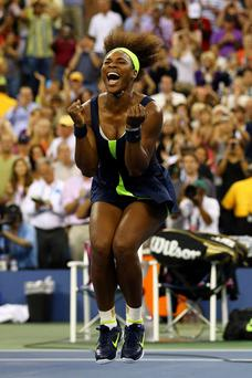 NEW YORK, NY - SEPTEMBER 09: Serena Williams of the United States celebrates match point after defeatig Victoria Azarenka of Belarus to win the women's singles final match on Day Fourteen of the 2012 US Open at USTA Billie Jean King National Tennis Center on September 9, 2012 in the Flushing neighborhood of the Queens borough of New York City. (Photo by Al Bello/Getty Images)