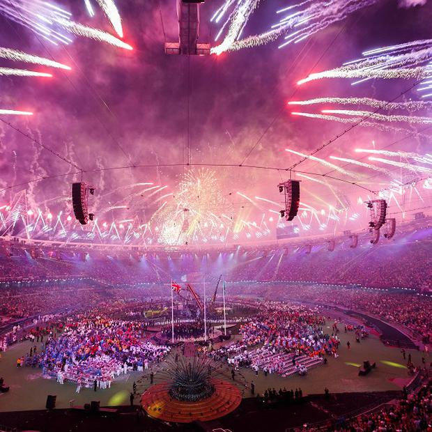 Fireworks explode over the Olympic Stadium during the Paralympic Games closing ceremony