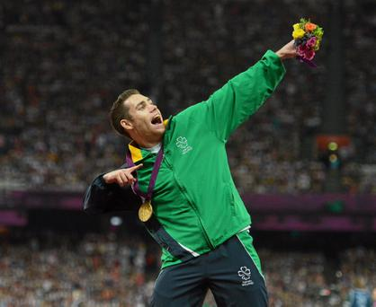 Jason Smyth, from Eglinton, Co. Derry, celebrates with his gold medal after the men's 200m - T13 final