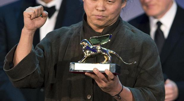 South Korean director Kim Ki-duk receives the Golden Lion for Pieta at the 69th Venice Film Festival (AP)