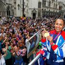 LONDON, ENGLAND - SEPTEMBER 10: British Olympic gold medal winning Heptathlete Jessica Ennis holds her gold medal as she takes part in the parade passing Royal Courts of Justice during the London 2012 Victory Parade for Team GB and Paralympic GB athletes on September 10, 2012 in London, England. (Photo by David Davies - WPA Pool/Getty Images)