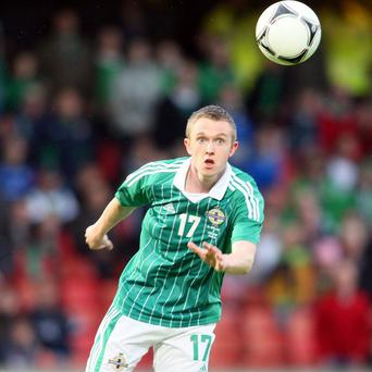 Shane Ferguson has shaken off a groin injury to join the Northern Ireland squad