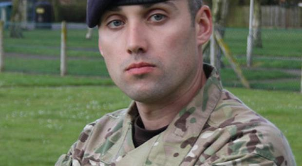 Sergeant Lee Paul Davidson, 32, from Doncaster, South Yorkshire from The Light Dragoons who was killed by a roadside bomb in Afghanistan (MoD/PA)