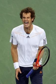 Andy Murray reacts during his men's singles final match against Novak Djokovic of Serbia on Day Fifteen of the 2012 US Open at USTA Billie Jean King National Tennis Center on September 10, 2012 in the Flushing neighborhood of the Queens borough of New York City. (Photo by Cameron Spencer/Getty Images)
