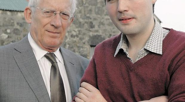 Nick Hewer with farmer Charlie Cole (right)