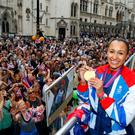 British Olympic gold medal winning Heptathlete Jessica Ennis holds her gold medal as she takes part in the parade for Team GB and Paralympic GB athletes