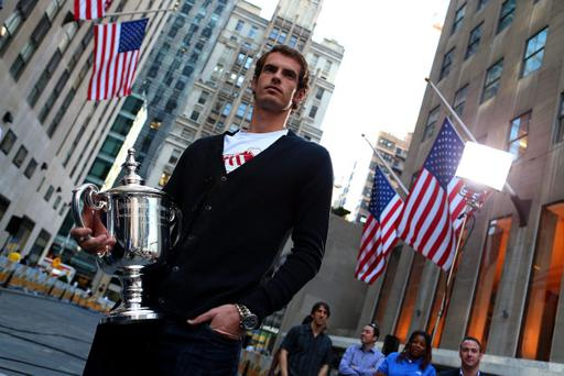 NEW YORK, NY - SEPTEMBER 11: Andy Murray of Great Britain poses with the US Open Championship trophy before an interview on the NBC Today Show during a New York City trophy tour on September 11, 2012 in New York City. (Photo by Clive Brunskill/Getty Images)