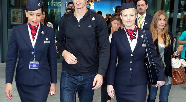 Andy Murray and girlfriend Kim Sears (right) arrive back at Terminal 5