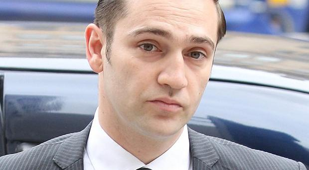 Reg Traviss has denied raping a woman on New Year's Eve