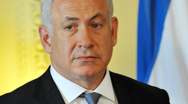 Israeli Prime Minister Benjamin Netanyahu has hinted he will take firm action against Iran over its nuclear capability