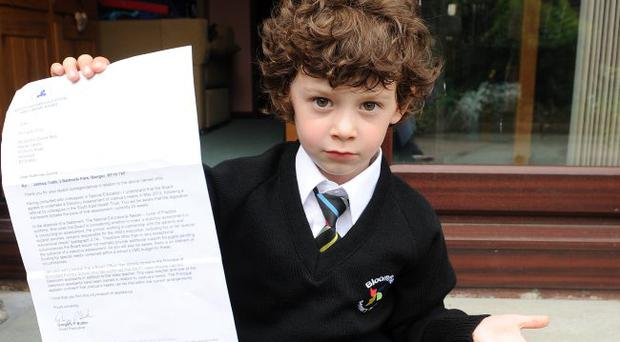 Josh Todd aged four pictured at his home in Bangor with a letter that his mum and dad Helen and David received from the Education board in relation to his type one diabetes and his education. Mandatory Credit - Picture by Presseye.com