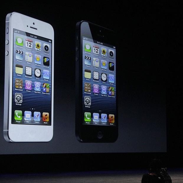 Phil Schiller, Apple's senior vice president of worldwide marketing, unveils the iPhone 5 (AP)