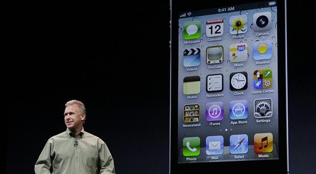 Phil Schiller, Apple's senior vice president of worldwide marketing, during an introduction of the new iPhone 5 (AP)